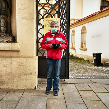 Miroslav (64) wearing a protective mask begs in front of the Church of the Assumption of the Blessed Virgin Mary.