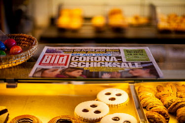 'Corona-Destinies' announces a copy Germany's biggest newspaper Bild Zeitung left on the counter of a bakery shop.