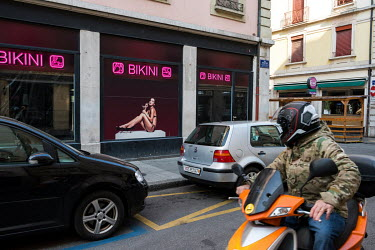 A man turns to look at an erotic image decorating the window of a place of prostitution in the red light district. All prostitution has been banned as part of Switzerland's lockdown measures in respon...