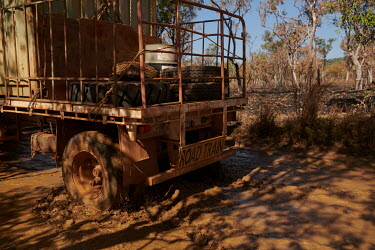 The vehicle drives through a muddy creek on the Gibb River Road, as Nick and Joanna Atkins' road train makes its way from Kununurra to Kalumburu.