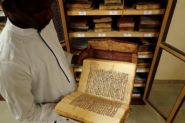 El Hadj Sissi, the son of the Imam of the main mosque in the city (the Djiengaraiber mosque), with some ancient manuscripts that they managed to save from destruction by Islamist insurgents by hiding...
