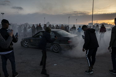 Spectators filming with their smart phones as members of the BMW drifting club perform stunts, in their imported German cars, at a rally in support of the Libyan National Army in Revolution Square.