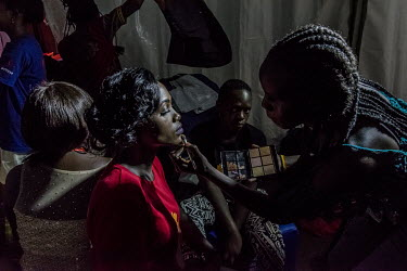 A makeup artist applies a final make-up touch up to the face of Vivian Nabanoba, a candidate and the eventual female winner, in the Y+ beauty contest. The Y+ beauty contest is national competition wit...