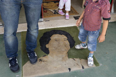 A door mat with the image of Muammar Gaddafi at the entrance to the Museum of the Revolution on Tripoli Street. Visitors wipe their feet on the former Libyan leader to ritually humiliate him.