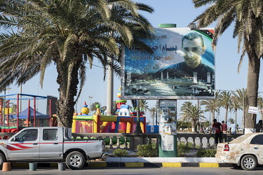 A billboard with the portrait of a martyr of the Libyan Revolution on Martyr's Square.