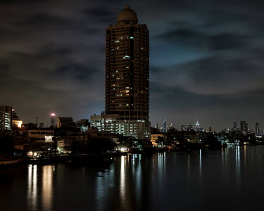 Overlooking the Chao Phraya river from Phra Pok Klao Bridge, connecting the districts of Phra Nakhon and Thonburi.