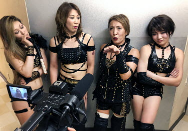 Mayumi Ozaki (51) talks as the members of the female wrestling team 'Seikigun' are interviewed after a bout at an Oz Academy Women's Pro-Wrestling competition held at the Shinjuku Face arena.