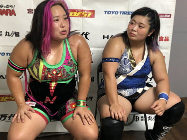 Chihiro Hashimoto (Sendai Girls) and her opponent, Yu (blue), are interviewed after their bout at a women's wrestling competition held at the Shin-Kiba 1st Ring in the Shinkiba district.