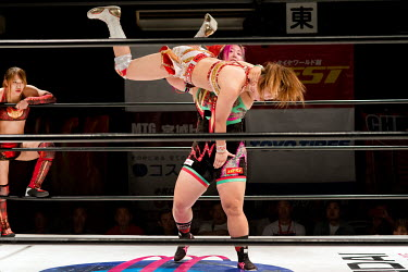 Chihiro Hashimoto (Sendai Girls) performs a 'slam' on her opponent during a bout at a women's wrestling competition held at the Shin-Kiba 1st Ring in the Shinkiba district.