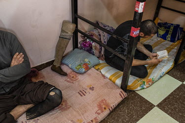Inmates relaxing in their living quarters at a special rehabilitation prison for drug addicts arrested and convicted as a result of operations targeting the illegal drug trade in southern Iraq.