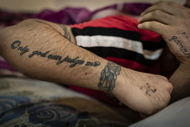 An inmate shows off a tattoo that reads in English 'Only god can judge me', in a special rehabilitation prison for drug addicts arrested and convicted as a result of operations targeting the illegal d...