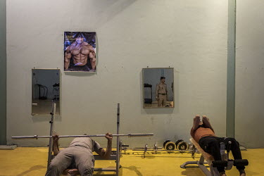 Inmates exercise in a gym at a special rehabilitation prison for drug addicts arrested and convicted as a result of operations targeting the illegal drug trade in southern Iraq.