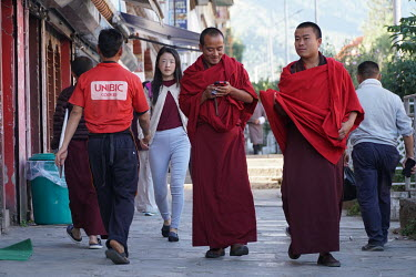 Monks and civilians walking in the city centre.