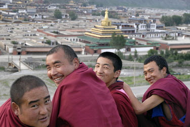 Buddhist monks looking over the Labrang Monastery in the ethnic Tibetan village of Xiahe.