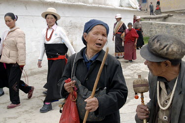 An elderly blind couple walks the Kora (Circumambulation), with other Buddhist pilgrims, around the Labrang Monastery in the ethnic Tibetan village of Xiahe.