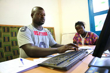 A pregnant woman being registered at the 'Ceu e Terras' health centre.