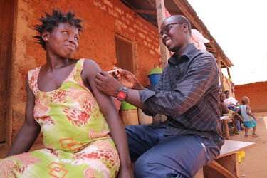 Health worker Ulil Balo gives a pregnant woman a tetanus vaccination via injection during an immunisation session that is part of an outreach program that aims to reach all communities and vaccinate a...