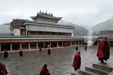 Buddhist monks gather in the main Prayer Hall of Grand Sutra hall of Labrang Monastery.
