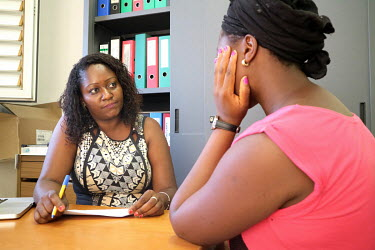 A pregnant woman receives the result of her HIV test from a counsellor at the 'Ceu e Terras' health centre.