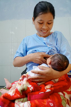 Bnuoch Thi Tiec breastfeeds her new born baby on the maternity ward at the Dong Giang District Health Centre.