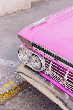 A detail of a restored 1959 Chevrolet Impala used as a tourist taxi.   Since the Cuban government put a heavy focus on tourism to drive GDP, taxi drivers (in both classic cars and regular vehicles) ha...