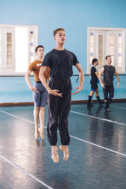 Ballet dancer Cosme Tablada (22) practices in the Ballet Nacional de Cuba rehearsal studios.