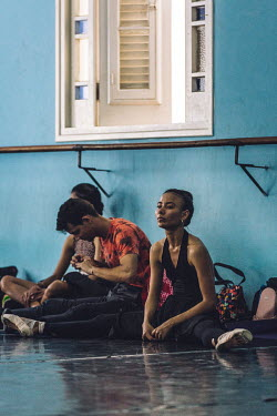 Maria Karla Iglesias (22), a dancer (corps de ballet) at the Ballet Nacional de Cuba, watches training take place in the company's rehearsal studio.