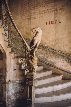 A headless statue at the bottom of the main stairway leading up to Restaurante La Guarida in La Habana, Cuba. The restaurant was one of the central locations for the 1993 Spanish language film 'Fresas...
