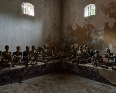 A reconstruction of a cell in the Phu Hai prison, built in 1862 during the French colonial-era. The room could contain 120 prisoners chained to a metal bar by their ankle.