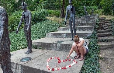 A woman pays tribute to Dr. Milada Horakova, the only woman executed by the communist regime, at the Memorial to the Victims of Communism on the 70th anniversary of her death.