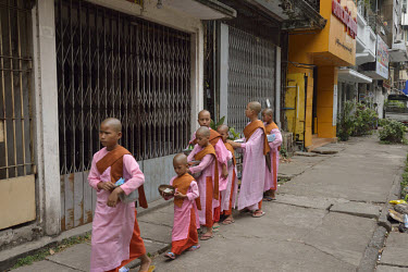 Novice monks out collecting alms.