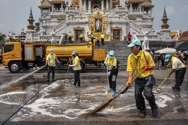 Volunteers disinfect and clean The Temple of the Golden Buddha (Wat Traimit).
