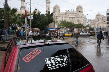 A sticker advocating violence against women on the rear windscreen of a car parked near the Abu Abbas al-Mursi mosque where people are heading for for Friday prayers.