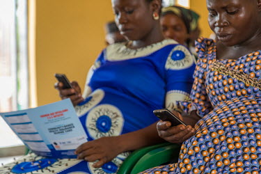 At the Okpekpe Primary Health Center 1, pregnant women use there mobile phones to get conversant with the use of Women Health and Action Research Centre (WHARC) Rapid SMS initiatives as part of WHARC...