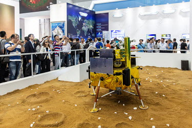 Visitors look at a model of the Chinese Lunar Lander at the China International Aviation & Aerospace Exhibition.