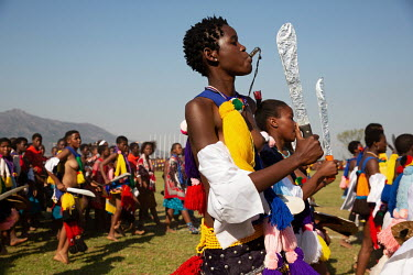 Young women ('maidens') take part in the Swazi Umhlanga or 'Reed Dance' in the Ludzidzini Royal Residence.