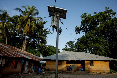 A solar panel that is part of a village-wide system that powers street lights and supplies the houses with electricity.