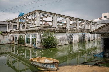 The flooded shell of an abandoned former office building in the district of Muara Baru. Due to rising sea levels and the over-extraction of groundwater, Jakarta is considered as one of the world's fas...