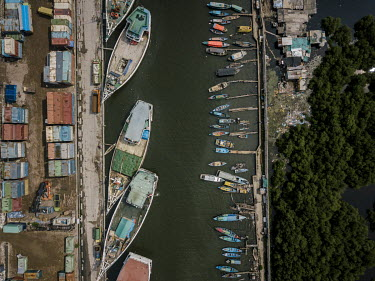 Boats moored beside the Jakarta Bay seawall. Due to rising sea levels and the over-extraction of groundwater, the capital is one of the world's fastest sinking cities.