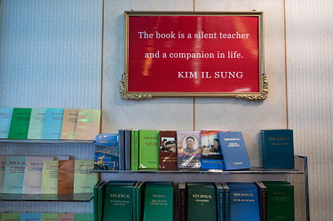Books and a quote, published in English, written by Kim Il Sung and Kim Jong Il on display at a small hotel.