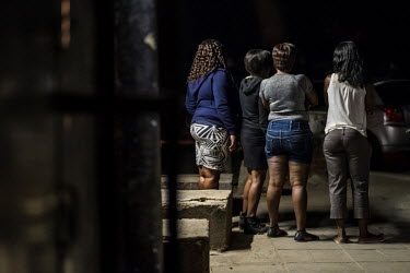 Sex workers waiting for clients on a roadside in the mining town of Selebi Phikwe.