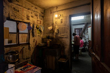 A residential property, in one of the last shanty districts of Shanghai, where the kitchen walls are lined with newspapers.