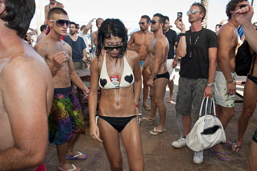 People dance during a party at the Bora Bora open air disco on the Playa Den Bossa beach Eivissa.