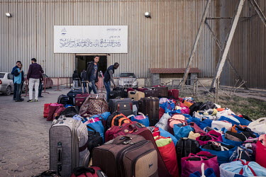Luggage at Tripoli's airport before a group of migrants are flown to an UNHCR (United Nations High Commissioner for Refugees) relocation centre in Niamey, Niger.