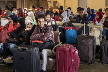 Migrants wait at Tripoli's airport from where they are due to be flown to an UNHCR (United Nations High Commissioner for Refugees) relocation centre in Niamey, Niger.