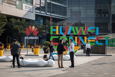 Visitors wait to enter the Huawei Connect 2017 conference.