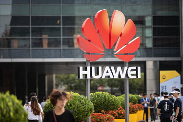A company logo stands outside the Huawei Connect 2017 conference.