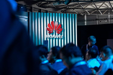 Attendees crowd into a conference room ahead of the keynote address at the Huawei Connect 2017 conference.