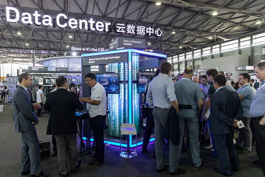 Visitors look at exhibitors booths at the Huawei Connect 2017 conference.