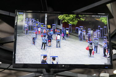 A screen showing AI tracking technology on display at the Huawei Connect 2017 conference.